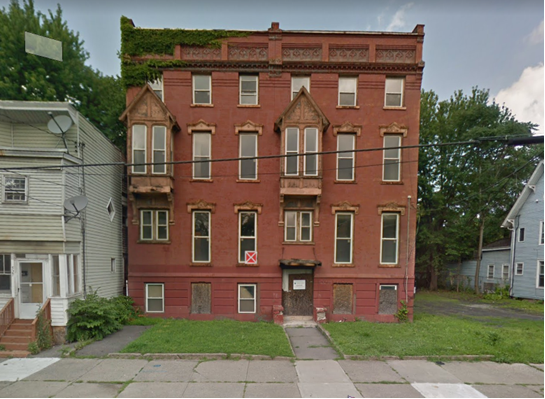 Photo of a small brick multifamily building in Albany to be revitalized